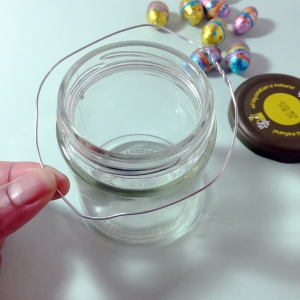 Twist a length of wire together to make a wire circle, bigger than the circumference of your jar.