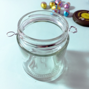 Place the wire circle around the rim of the jar and twist the two opposite ends to make two loops.